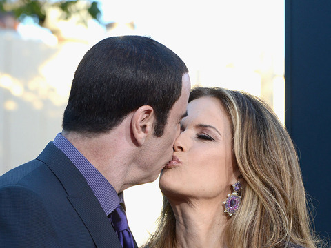 John Travolta and Kelly Preston Step Out at 'Savages' Premiere