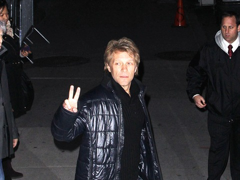 "Jon Bon Jovi waved to photographers while leaving the ""Late Show with David…"