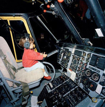 Pics! Never-Before-Seen Photos of a Young JFK Jr. Playing in Cockpit