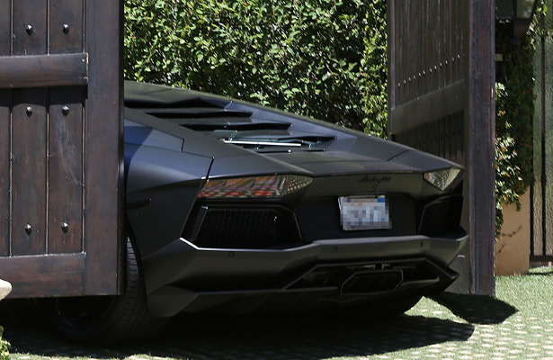 Kanye wests 750k lamborghini nearly crushed by kim kardashian gate kanye wests 750k lamborghini nearly crushed by kim kardashian gate extratv publicscrutiny
