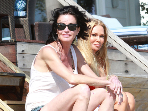 Janice Dickinson and her friend were snapped on the beach in Malibu, CA.