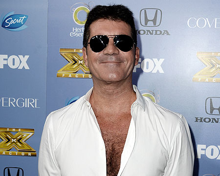 Simon Cowell Jokes About Diaper Duty