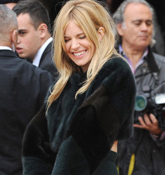 Sienna Miller attended London Fashion Week's Burberry Prorsum show on Tuesday.