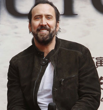 "Nicolas Cage attended an ""Outcast"" press conference in Beijing."