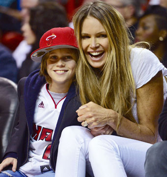Elle MacPherson and son Cy Busson sat courtside at Miami Heat's winning home…