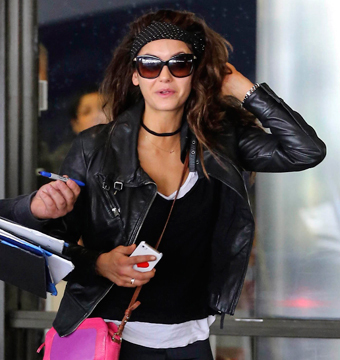 """Vampire Diaries"" star Nina Dobrev was greeted by fans as she arrived to LAX on…"