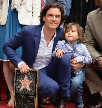 Orlando Bloom, pictured with son Flynn, received a star on the Hollywood Walk…