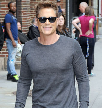 "Rob Lowe smiled for the cameras as he arrived to ""The Late Show with David…"