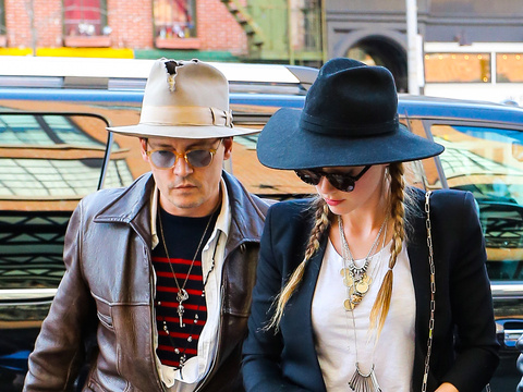 Johnny Depp and Amber Heard were spotted entering their hotel in NYC.