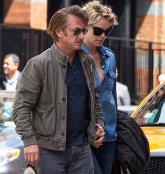 Sean Penn and Charlize Theron held hands while taking a stroll in NYC.