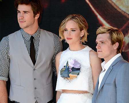 "Liam Hemsworth, Jennifer Lawrence and Josh Hutcherson pose for a ""Hunger Games:…"