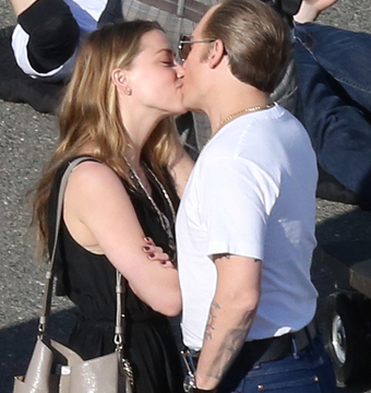 "Amber Heard and Johnny Depp shared a romantic kiss on the set of ""Black Mass""…"