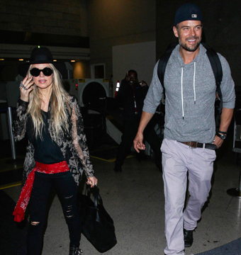 Fergie and Josh Duhamel touched down at LAX.