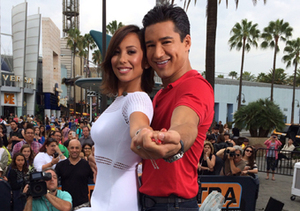 "Host Mario Lopez poses with ""Extra"" special co-host Cheryl Burke."