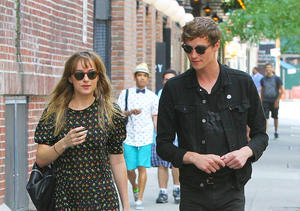 """Fifty Shades of Grey"" star Dakota Johnson took a stroll with a mystery man in…"