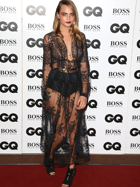Wild Night! Cara Delevingne Wrestles Fashion Designer at GQ Awards