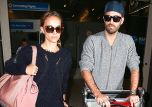 Natalie Portman and Ben Millepied touched down at LAX.