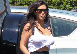 Kim Kardashian showed off her curves in a white crop top and black skirt in L.A.