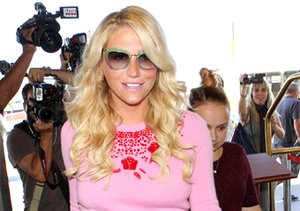 Kesha was the center of attention as she strolled through LAX.