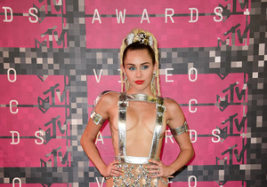 Miley Cyrus Goes Topless... Again!