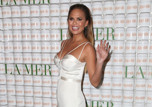 Video! Chrissy Teigen Shows Off Barely There Baby Bump on La Mer Red Carpet