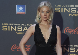 Watch Jennifer Lawrence Fall on the Red Carpet at 'Mockingjay' Madrid Premiere