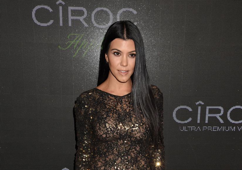 Kourtney Kardashian Plays Basketball in Leopard-Print Bikini before Secret Family Trip