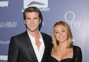 Miley Cyrus & Liam Hemsworth Spotted 'Kissing and Holding Hands' at…