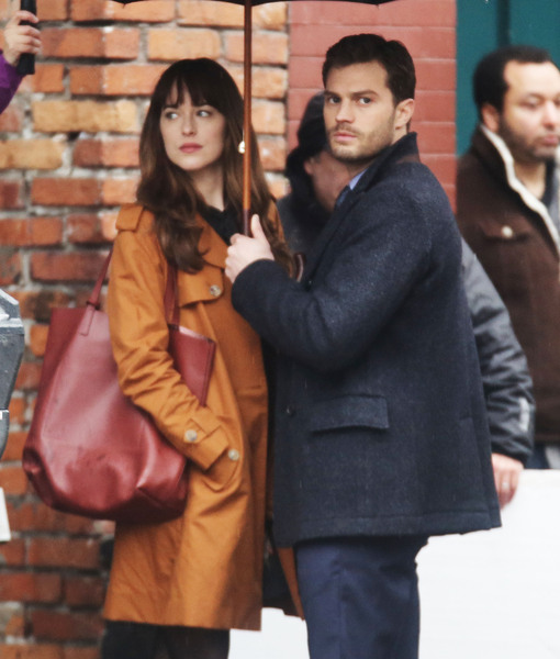 Dakota Johnson & Jamie Dornan Kiss in the Rain on 'Fifty Shades Darker' Set
