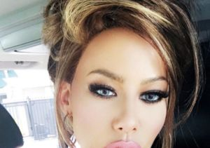 Amber Rose Unrecognizable in Brunette Wig and Crystal Blue Contacts