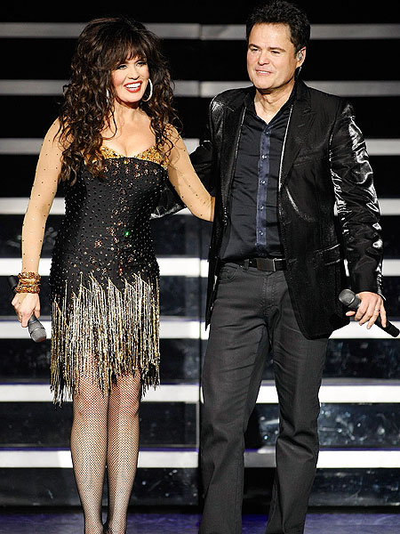 Marie and Donny Osmond performing
