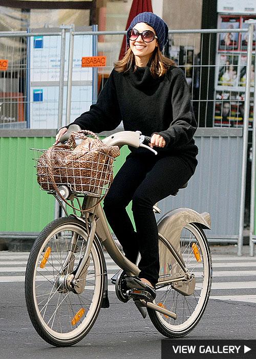 Jessica Alba rides a bike