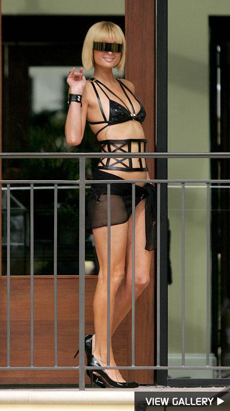 Paris Hilton wears a bondage bikini