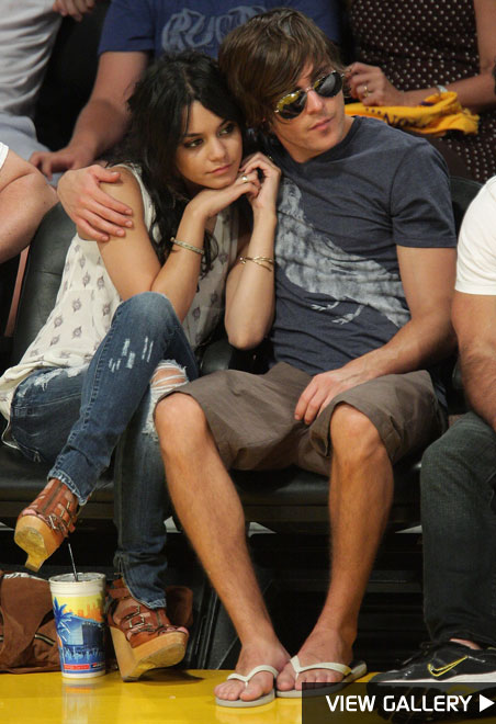 zac efron and vanessa hudgens cuddling lakers game