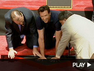 Hugh Jackman sets his handprints in the Mann's Chinese Theater courtyard.