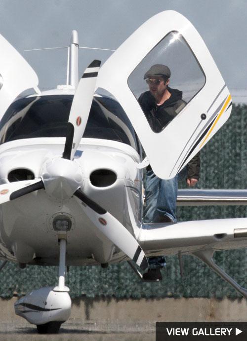 brad pitt pilot lessons airport plane