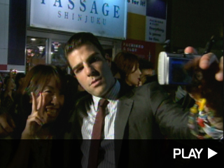 Zachary Quinto takes a picture with a fan.