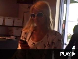 Paris Hilton arrives at Extra