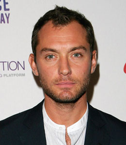 Jude Law whacked a female photographer on the noggin in London on Wednesday night.