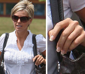 Kate Gosselin was photographed Friday for the first time without her wedding band