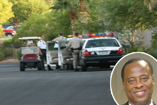 Officials raided the Las Vegas home of Michael Jackson's personal physician on Tuesday morning.