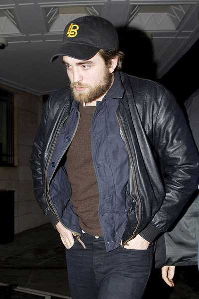 Robert Pattinson was photographed with an unruly, wolfman-style beard in London.
