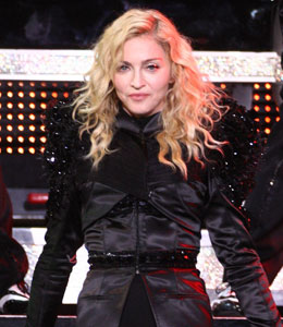 Madonna paid tribute on Thursday night to the two people who lost their lives while constructing her concert stage in France.