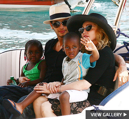 madonna, kids and jesus luz ride in a gondola