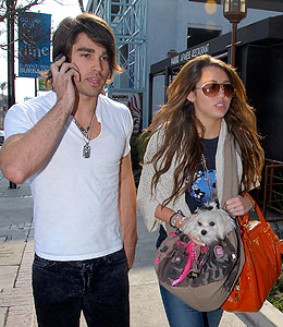 miley cyrus says goodbye to justin gaston