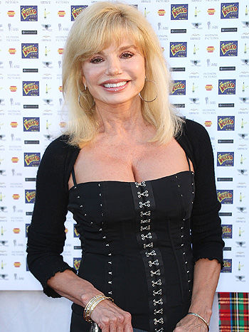 0793bb54de1d Loni Anderson, who turned 63 this week, was every bit the corseted sex  symbol at the Hollywood premiere of