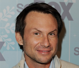 'Extra' Caught 'Breaking In' with Christian Slater