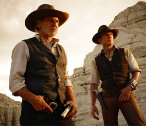 'Cowboys & Aliens' and 'Smurfs' Invade Theaters This Weekend