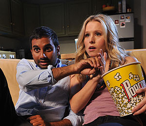 Aziz Ansari Gets a Little Too Cozy with Kristen Bell