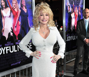 Extra Scoop: Dolly Parton Reveals New Flower Tattoo